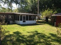 Canal Front Home off St.Johns River sleeps 4 ~canal-front dock