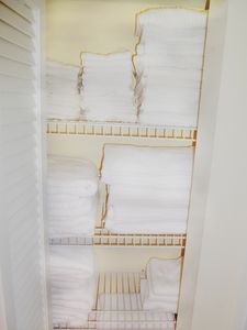 Master bedroom linen closet, all white towels