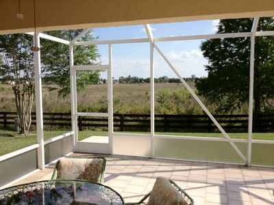 The oversized screened in lanai overlooks a Grass Pond Nature Preserve.