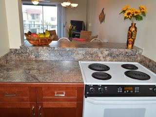 Ormond Beach condo photo - Kitchen is open to Dining and Living Rooms