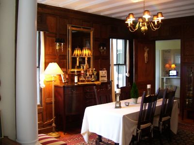 Formal wood paneled dining room