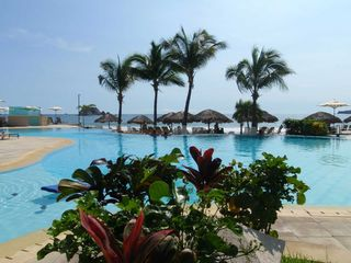 Ixtapa condo photo - 2 Infinity pools on the edge of the Ocean, viewable from our terrace.