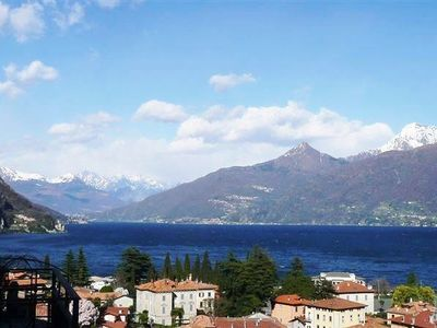 Snow capped mountains over Lake Como