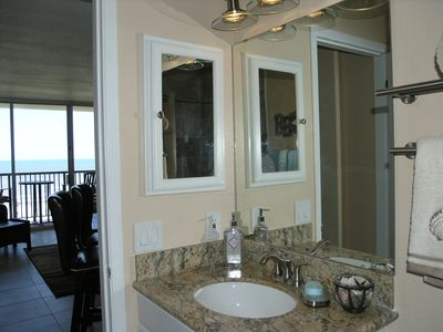 Bath has new granite top vanity, medicine cabinet, storage under sink.