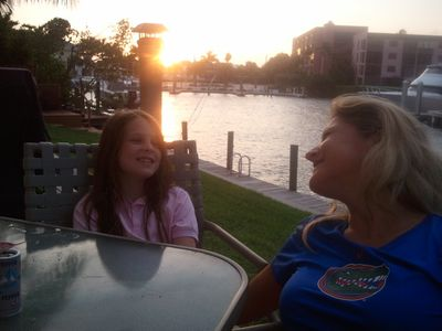 The girls enjoying another beautiful Naples Bay sunset on the back deck!
