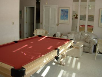 den with billiard table. The open door leads to the laundry & garage