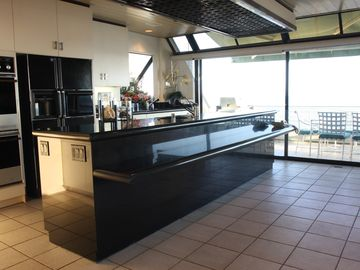 Kitchen with full length serving area for guests.