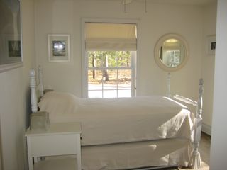 Brewster house photo - Small Bedroom with popup twin bed trundle below, two side tables.