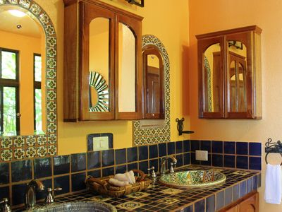 Sunny master bath features hand painted Mexican tiles & double sinks