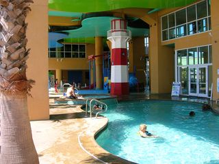 Splash Resort condo photo - Covered Pool and spa
