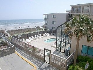 Crescent Beach condo photo - Hot tub, sun deck and Pool building - All visible from our unit