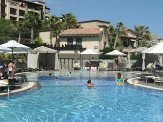 Cool off and enjoy a refreshing drink and swim. - Cabo San Lucas villa vacation rental photo