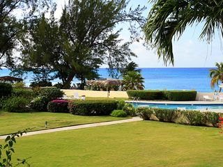 Grand Cayman condo photo - View of garden pool and sea