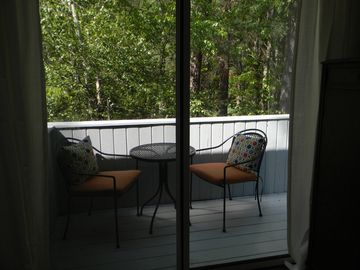 Outdoor deck and seating off of master bedroom