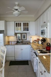 Full Kitchen with granite countertops, dishwasher and garbage disposal