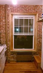Queens studio photo - Large Windows. Exposed Brick Wall. Hard Wood Floors. High Ceilings.