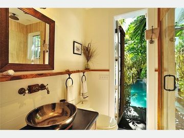 The 2nd bathroom has direct access to the pool.