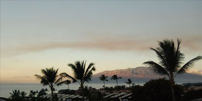 Kihei condo rental - Sunrise on west Maui mountains - seen from main lanai