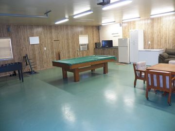 Game Room with pool table, game table, tv/dvd, 2nd refrigerator, freezer & sofa