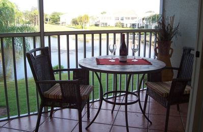 rear lanai overlooking lake, palm trees and golf course