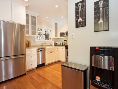 Kitchen with hot & cold filtered water dispenser.