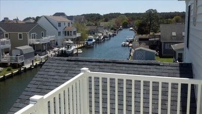 View of canal from upstairs master bedroom deck.