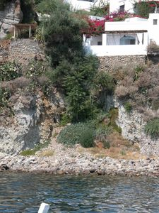 Frontal view of the house on the rocks