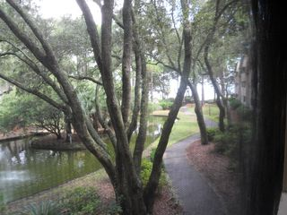 Port Royal villa photo - View from deck of lagoon, sound, & walkway to grill area & beach.