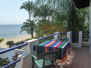 Large balcony for both upstairs suites look over the pool & ocean - Bucerias townhome vacation rental photo