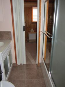 Shared bathroom with tub/shower, toilet and sink between Bedrooms 2 and 3