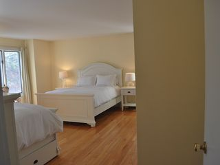 East Quogue house photo - Master bedroom 2 with queen, full bed and trundle and view onto vegetable garden
