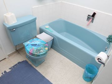 Shared bathroom on 2nd, shower, tub, two sinks.