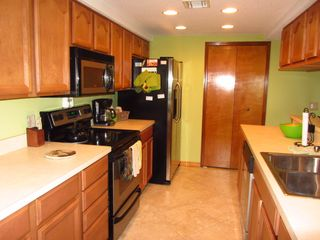 Kitchen with Stainless appliances - Cocoa Beach condo vacation rental photo