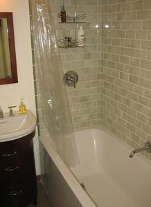 Soaking tub for two, shower, vanity for storage
