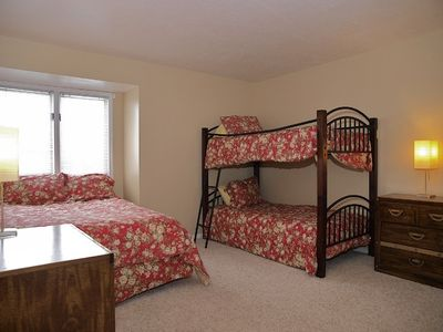 3rd bedroom with queen bed and bunk beds