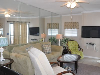 The den is newly decorated with your comfort in mind.  Notice the mirrored wall