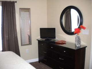 Splash Resort condo photo - 19 inch flat screen with built in DVD player in the master bathroom