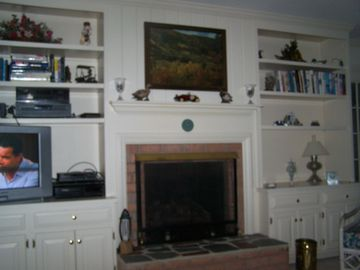 Family room with gas fireplace and entertainment center