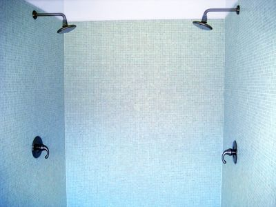 the master two person glass-tiled shower