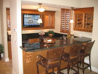 Flagler Beach condo photo - Wet Bar with Plasma TV, Wine Cooler & Ice Maker