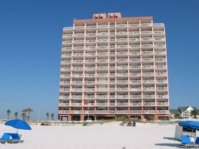 View Of Royal Palms complex from beach. Unit 306 is right behind flag.