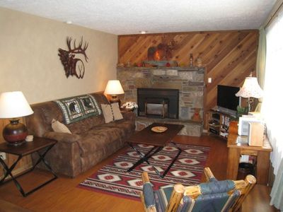 Cozy Living room with natural gas fireplace. Direct TV & Free WIFI