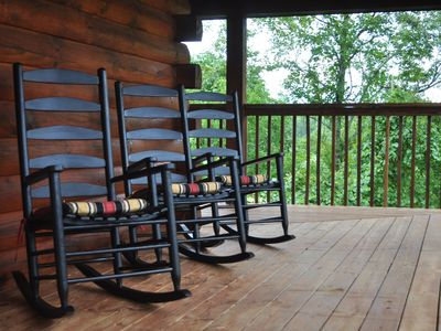 Relax on the double-sided covered porch overlooking the mountain range.