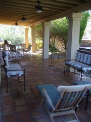 Goodyear house photo - patio sitting with dining for six lots of seating areas under cover