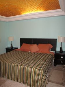 2nd bedroom with king size bed, large closets and beautiful arched ceiling.
