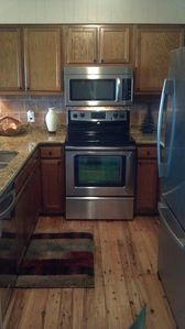 Kitchen has new granite countertops and brand new stainless steel appliances