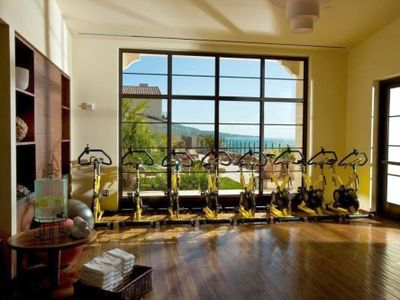 The fitness center with a spin/yoga studio sits directly across from the spa.