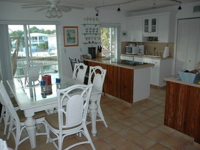 Dinning room with basin view and full kitchen. Washer and dryer