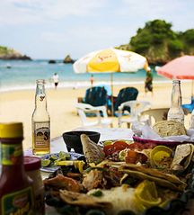 Huatulco condo photo - Enjoy a cerveza under a palapa at Playa Panteon