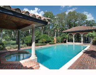 Tampa house photo - Olympic size pool and heated spa gated in center of estate